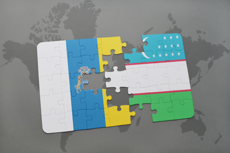 canary islands: puzzle with the national flag of canary islands and uzbekistan on a world map background. 3D illustration Stock Photo
