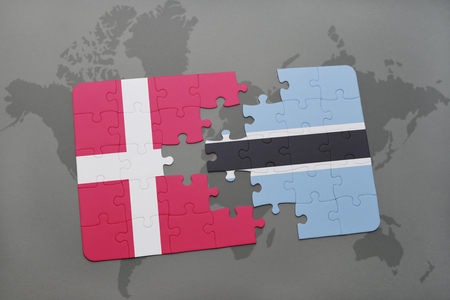 danish flag: puzzle with the national flag of denmark and botswana on a world map background. 3D illustration