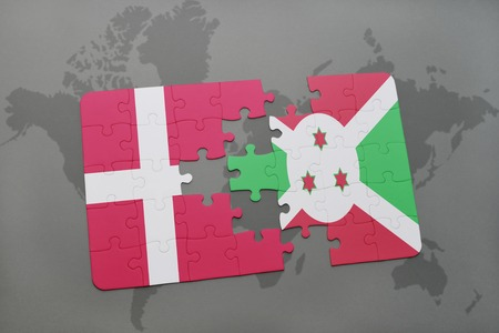 danish flag: puzzle with the national flag of denmark and burundi on a world map background. 3D illustration