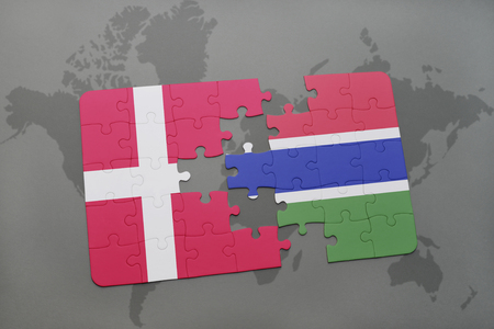 danish flag: puzzle with the national flag of denmark and gambia on a world map background. 3D illustration