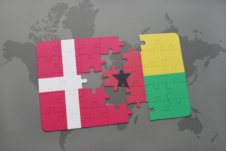 danish flag: puzzle with the national flag of denmark and guinea bissau on a world map background. 3D illustration