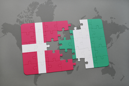 danish flag: puzzle with the national flag of denmark and nigeria on a world map background. 3D illustration
