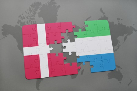 danish flag: puzzle with the national flag of denmark and sierra leone on a world map background. 3D illustration