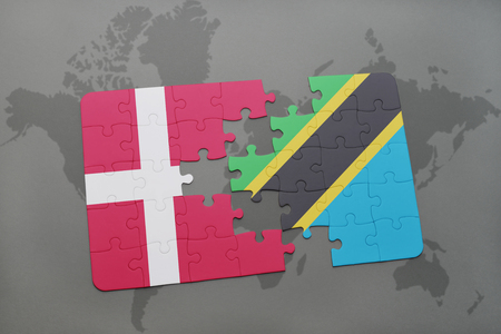 danish flag: puzzle with the national flag of denmark and tanzania on a world map background. 3D illustration