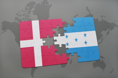 puzzle with the national flag of denmark and honduras on a world map background. 3D illustration Stock Photo