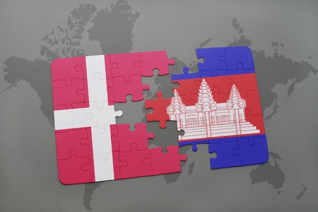 cambodian: puzzle with the national flag of denmark and cambodia on a world map background. 3D illustration