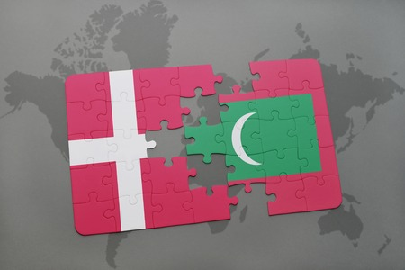danish flag: puzzle with the national flag of denmark and maldives on a world map background. 3D illustration Stock Photo