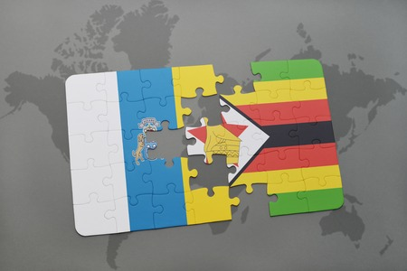 canary islands: puzzle with the national flag of canary islands and zimbabwe on a world map background. 3D illustration