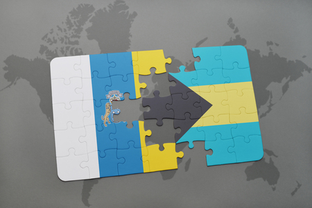 puzzle with the national flag of canary islands and bahamas on a world map background. 3D illustration