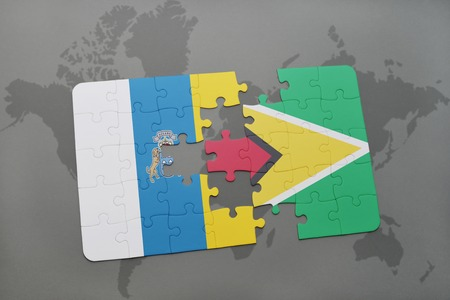 puzzle with the national flag of canary islands and guyana on a world map background. 3D illustration
