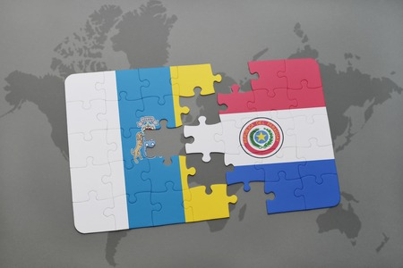 canary islands: puzzle with the national flag of canary islands and paraguay on a world map background. 3D illustration