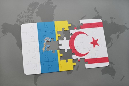 puzzle with the national flag of canary islands and northern cyprus on a world map background. 3D illustration Stock Photo