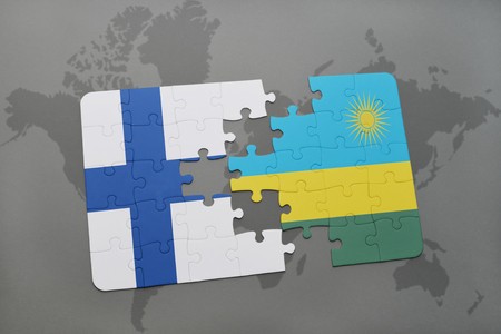 kigali: puzzle with the national flag of finland and rwanda on a world map background. 3D illustration Stock Photo