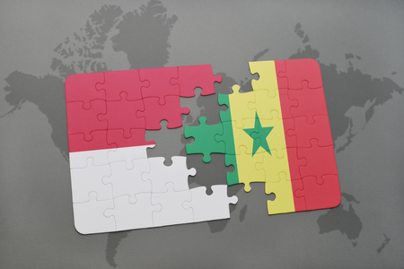 dakar: puzzle with the national flag of indonesia and senegal on a world map background. 3D illustration Stock Photo