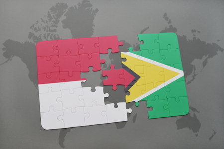 guyanese: puzzle with the national flag of indonesia and guyana on a world map background. 3D illustration