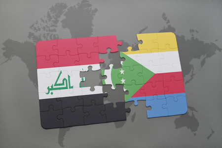 iraq conflict: puzzle with the national flag of iraq and comoros on a world map background. 3D illustration Stock Photo