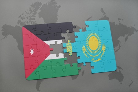 puzzle with the national flag of jordan and kazakhstan on a world map background. 3D illustration Stock Photo