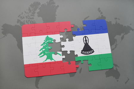 lebanese: puzzle with the national flag of lebanon and lesotho on a world map background. 3D illustration
