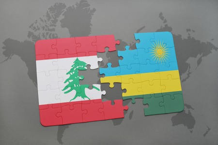 puzzle with the national flag of lebanon and rwanda on a world map background. 3D illustration