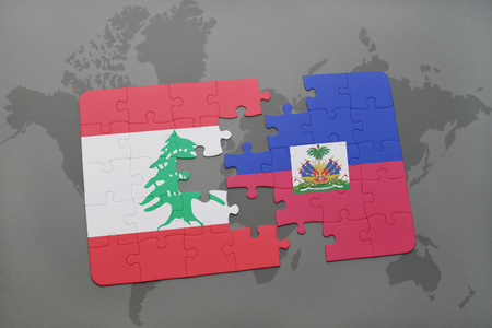 haitian: puzzle with the national flag of lebanon and haiti on a world map background. 3D illustration Stock Photo