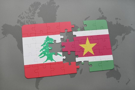 lebanese: puzzle with the national flag of lebanon and suriname on a world map background. 3D illustration