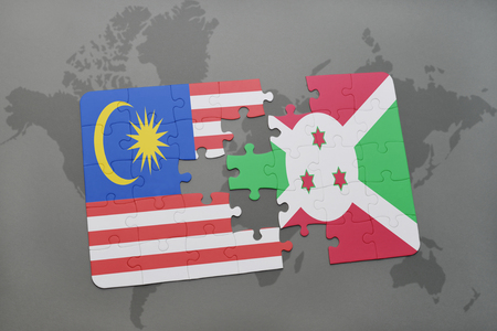 bujumbura: puzzle with the national flag of malaysia and burundi on a world map background. 3D illustration