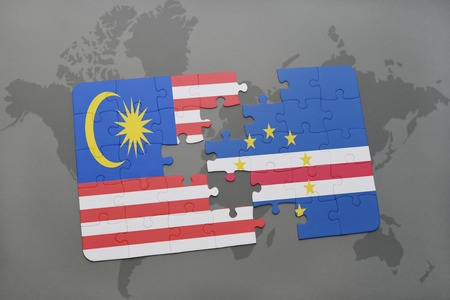 praia: puzzle with the national flag of malaysia and cape verde on a world map background. 3D illustration
