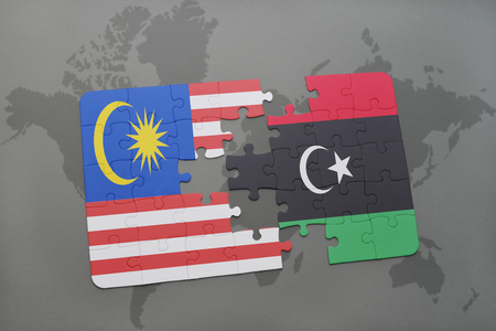 libya: puzzle with the national flag of malaysia and libya on a world map background. 3D illustration