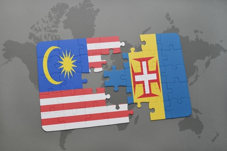 puzzle with the national flag of malaysia and madeira on a world map background. 3D illustration
