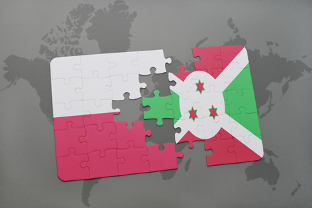 puzzle with the national flag of poland and burundi on a world map background. 3D illustration Stock Photo