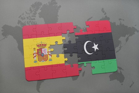 libya: puzzle with the national flag of spain and libya on a world map background. 3D illustration Stock Photo