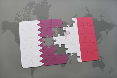 puzzle with the national flag of qatar and malta on a world map background. 3D illustration Stock Photo