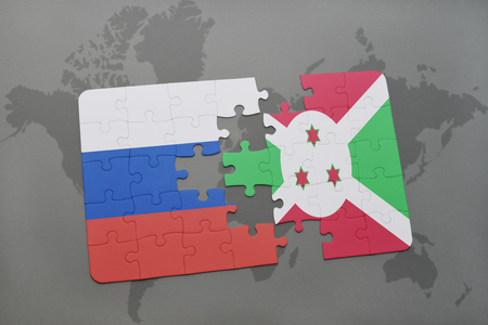 bujumbura: puzzle with the national flag of russia and burundi on a world map background. 3D illustration