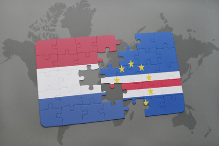 praia: puzzle with the national flag of netherlands and cape verde on a world map background. 3D illustration