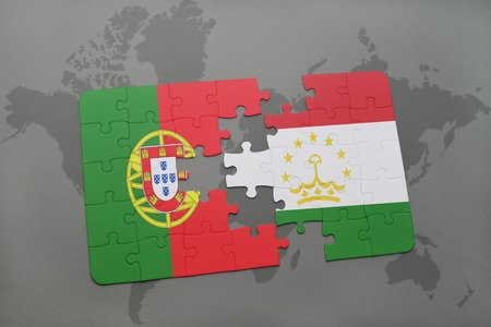 economy of tajikistan: puzzle with the national flag of portugal and tajikistan on a world map background. 3D illustration Stock Photo