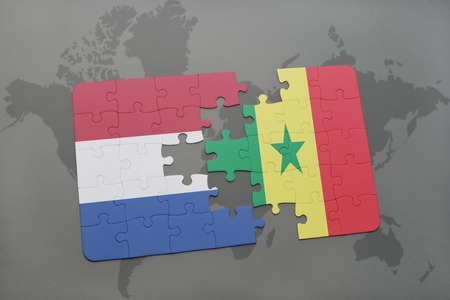 dakar: puzzle with the national flag of netherlands and senegal on a world map background. 3D illustration Stock Photo