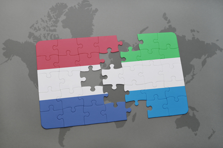 Waving scottish and dutch flags of the political map of the world puzzle with the national flag of netherlands and sierra leone on a world map background gumiabroncs Choice Image