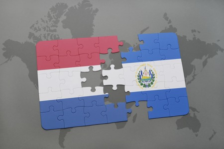 mapa de el salvador: puzzle with the national flag of netherlands and el salvador on a world map background. 3D illustration