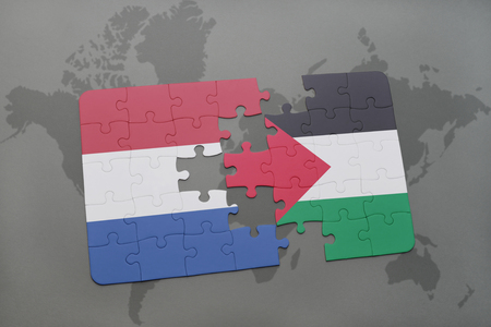 puzzle with the national flag of netherlands and palestine on a world map background. 3D illustration Stock Photo