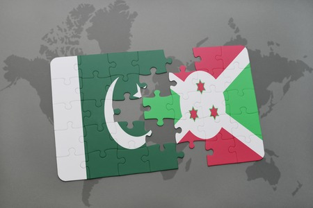 puzzle with the national flag of pakistan and burundi on a world map background. 3D illustration