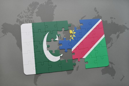 islamabad: puzzle with the national flag of pakistan and namibia on a world map background. 3D illustration Stock Photo