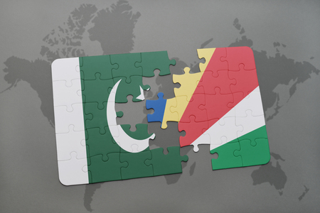 islamabad: puzzle with the national flag of pakistan and seychelles on a world map background. 3D illustration Stock Photo