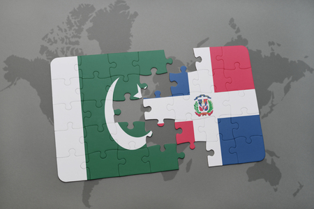 domingo: puzzle with the national flag of pakistan and dominican republic on a world map background. 3D illustration Stock Photo