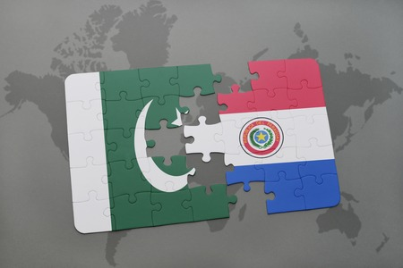 islamabad: puzzle with the national flag of pakistan and paraguay on a world map background. 3D illustration