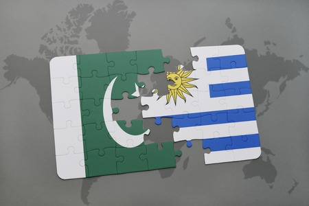 islamabad: puzzle with the national flag of pakistan and uruguay on a world map background. 3D illustration