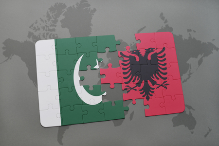 islamabad: puzzle with the national flag of pakistan and albania on a world map background. 3D illustration