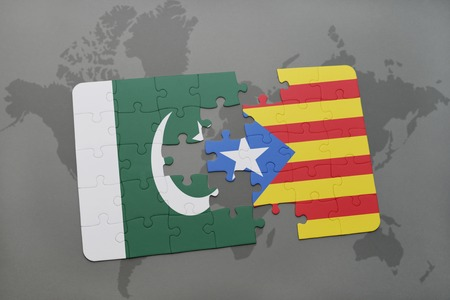 puzzle with the national flag of pakistan and catalonia on a world map background. 3D illustration