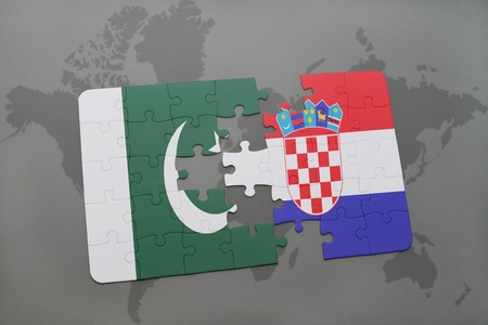 islamabad: puzzle with the national flag of pakistan and croatia on a world map background. 3D illustration Stock Photo