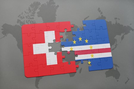verde: puzzle with the national flag of switzerland and cape verde on a world map background. 3D illustration Stock Photo