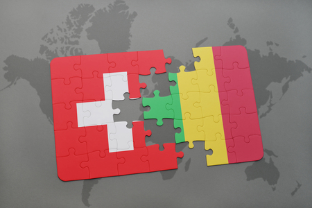 mali: puzzle with the national flag of switzerland and mali on a world map background. 3D illustration